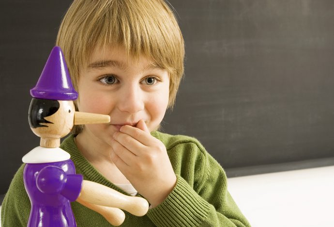 a boy with pinocchio toy